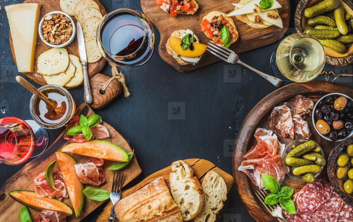 Italian wine antipasti snack variety over dark background