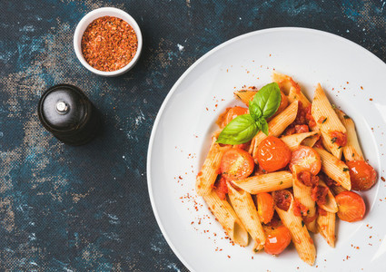 Pasta penne with tomato sauce  basil  roasted tomatoes  Copy space