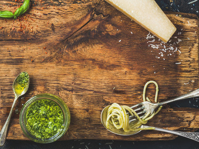 Italian cuisine cooking background on rustic wooden board texture