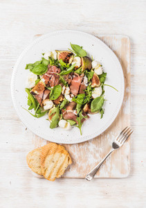 Prosciutto  arugula  basil  figs  mozzarella salad served with bread