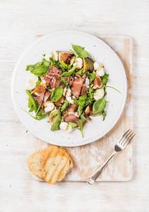 Prosciutto  arugula  basil  figs  mozzarella salad served with bread