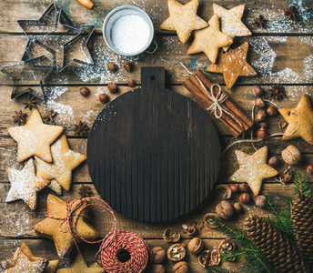 Christmas New Year background with dark wooden board in center