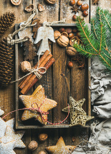 Wooden tray with cookies  decorative angels and stars  spices  nuts
