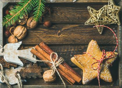 Sweet cookies  wooden angels  decorative golden stars  nuts  cinnamon sticks