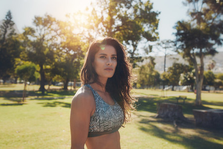 Fit young woman in sportswear at the park