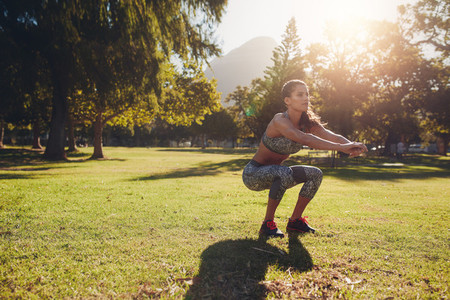 Young woman exercising in park on a nice summer day