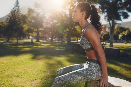 Fitness woman exercising at the park