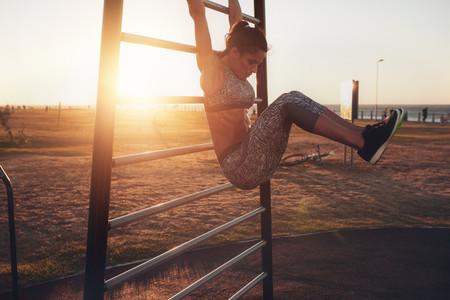 Woman performing hanging leg raises