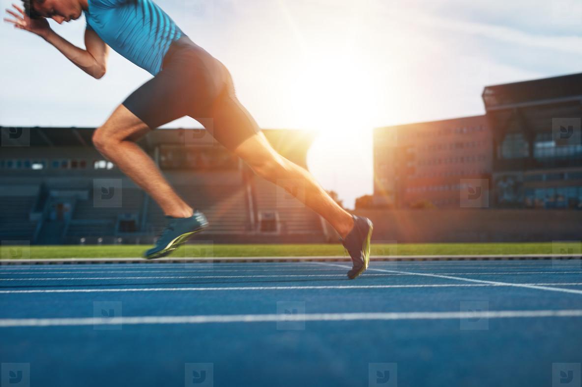 Runner practicing in athletics stadium