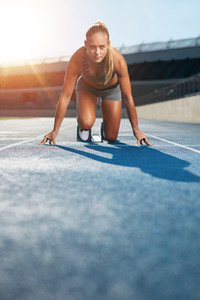 Determined sprinter at starting block