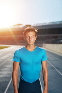 Young man after run on stadium race track