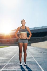 Runner on race track in athletics stadium