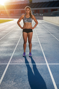 Female runner standing on race track