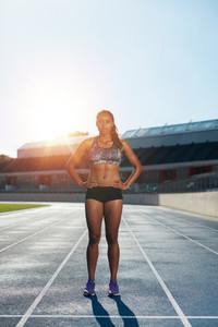 Professional female athlete on race track