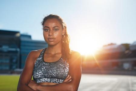 African female runner on race track