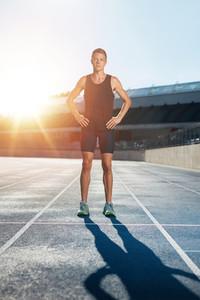 Sprinter on race track in athletics stadium