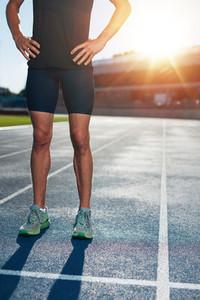 Runner on athletics running track in stadium