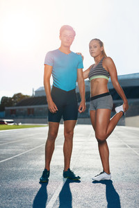Fit athletes on race track
