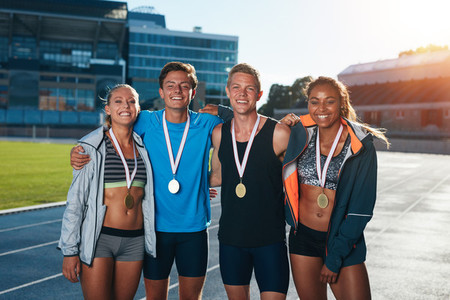 Group of athletes with medals