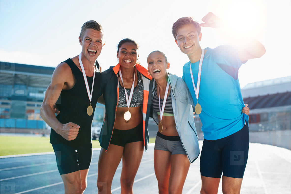 Team of athletes enjoying victory