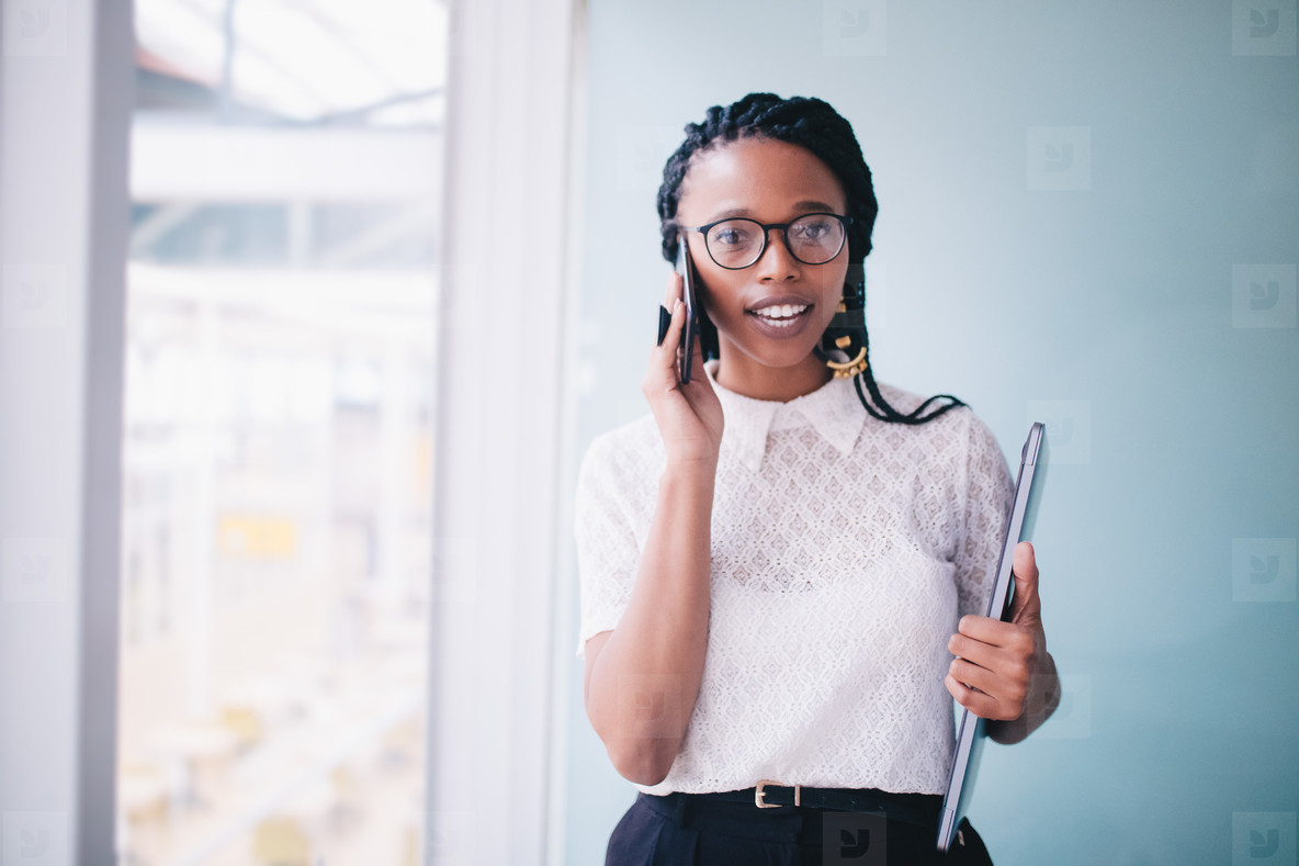 African businesswoman in a conversation on the phone