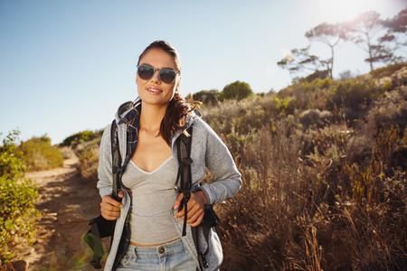 Beautiful hiker woman trekking in nature