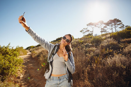 Young woman hiker a selfie in nature