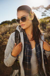 Attractive young female hiker in nature