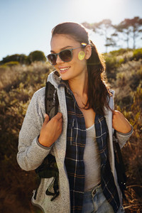 Happy young woman hiking on a sunny day