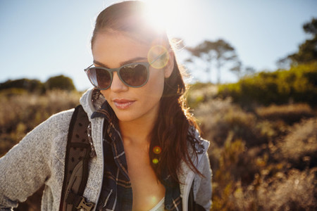 Woman hiking in a sunlit nature reserve
