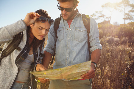 Hikers looking at map for navigation