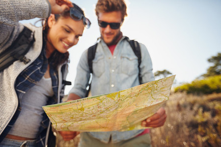 Couple reading map on country walk
