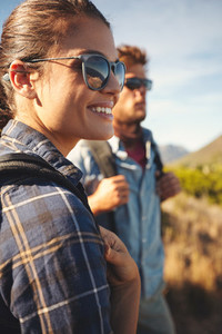 Hiker couple enjoying vacation in countryside