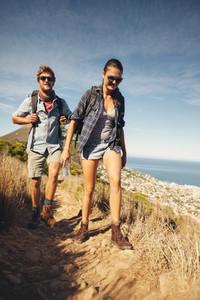 Avid hikers in countryside