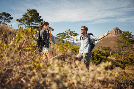 Hikers enjoying on summer vacation in countryside