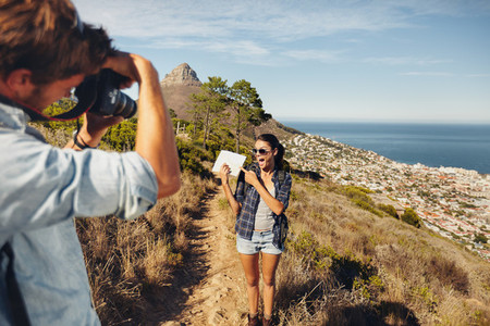 Couple hiking   Excited woman posing for a picture