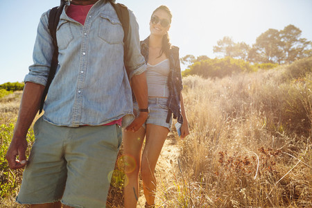 Young woman hiking in mountain with her boyfriend