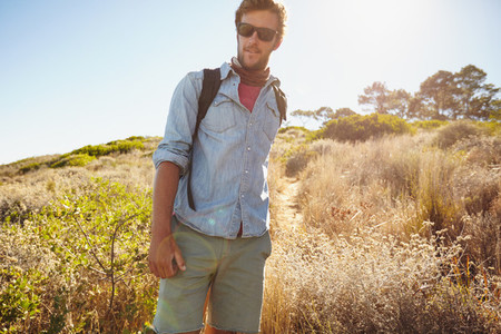 Handsome young man hiking in nature