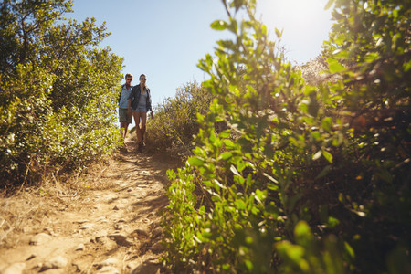 Young couple hiking on a summer day