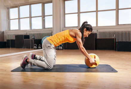 Young woman exercising with kettle bell