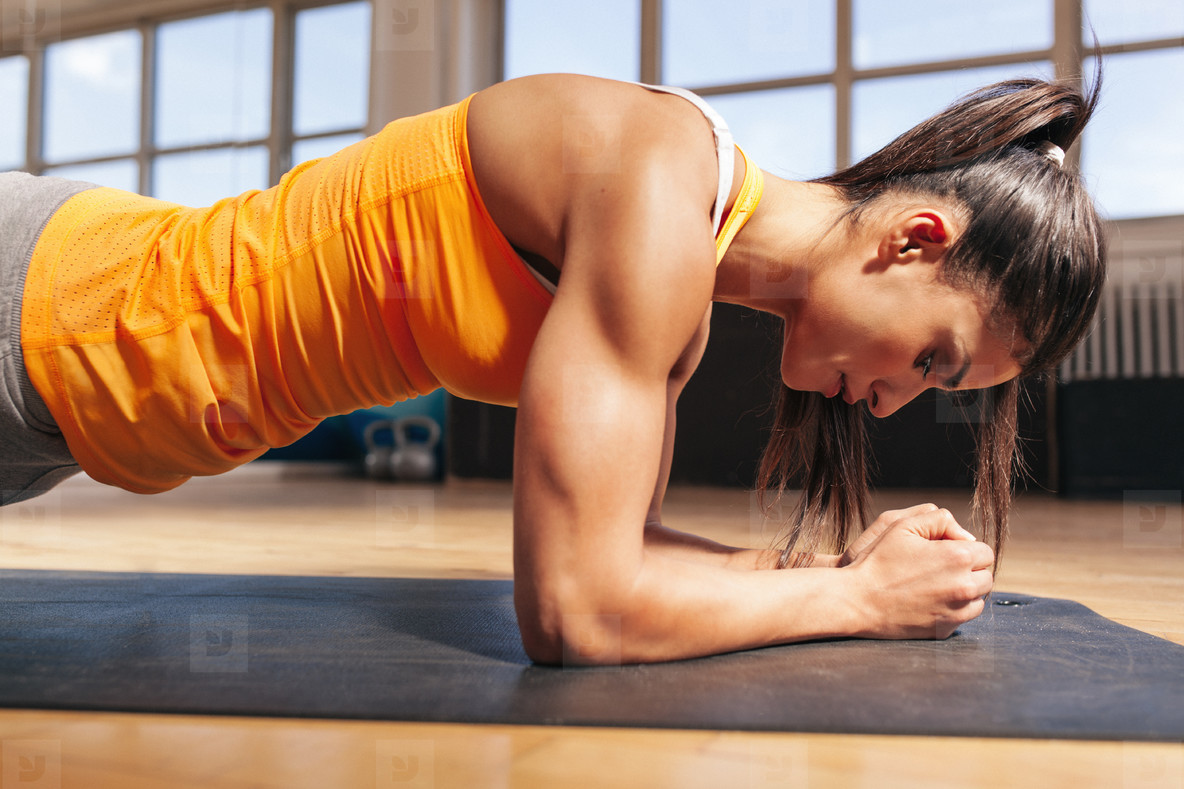 Woman doing press ups in gym