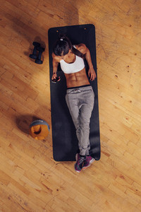 Workout break   Woman using mobile phone