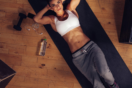 Determined woman ready to do sit ups