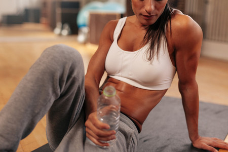 Fitness woman with water bottle at gym