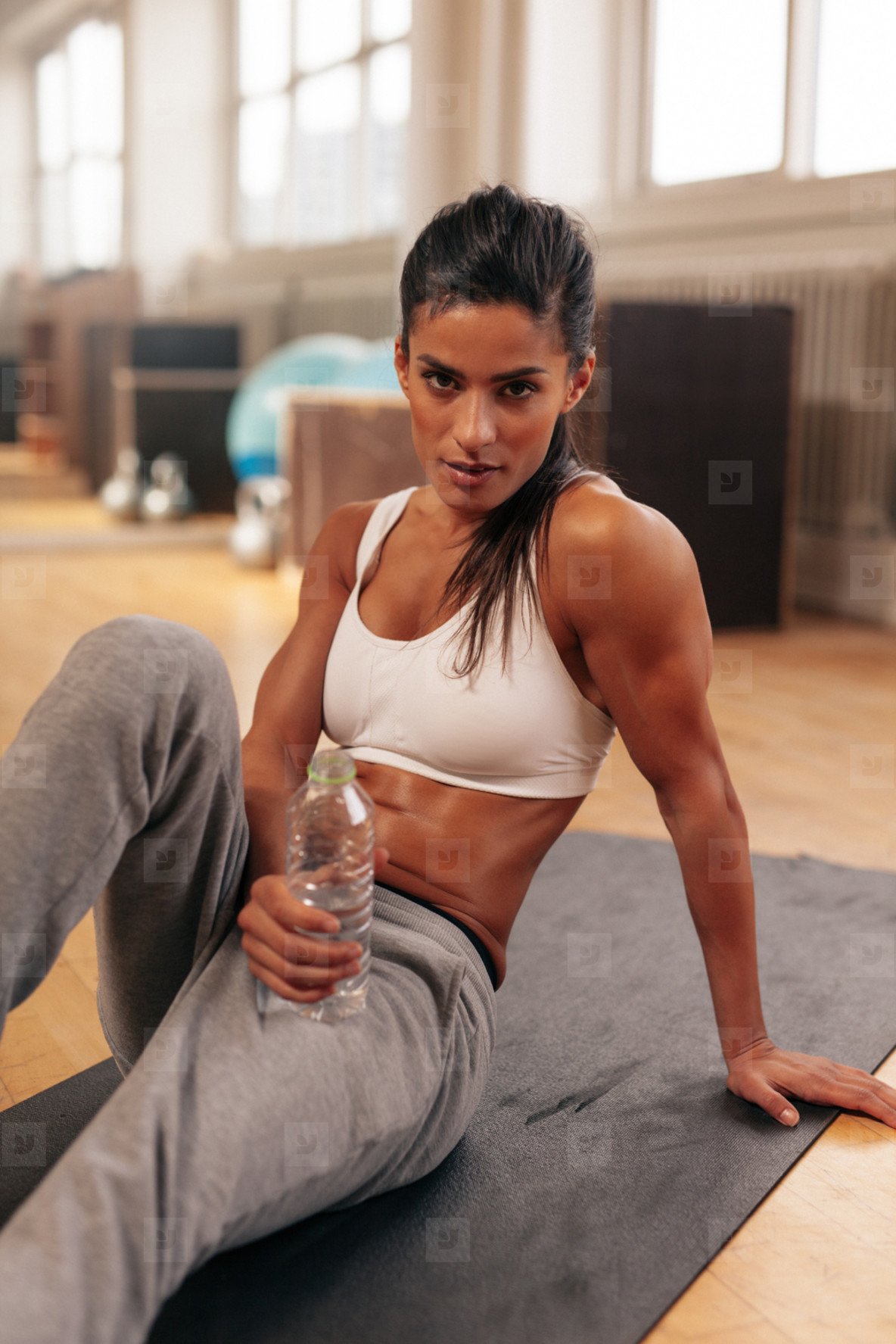 Fit woman relaxing after exercise