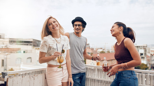 Friends having partying on rooftop