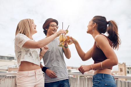 Young people enjoying cocktails at a party