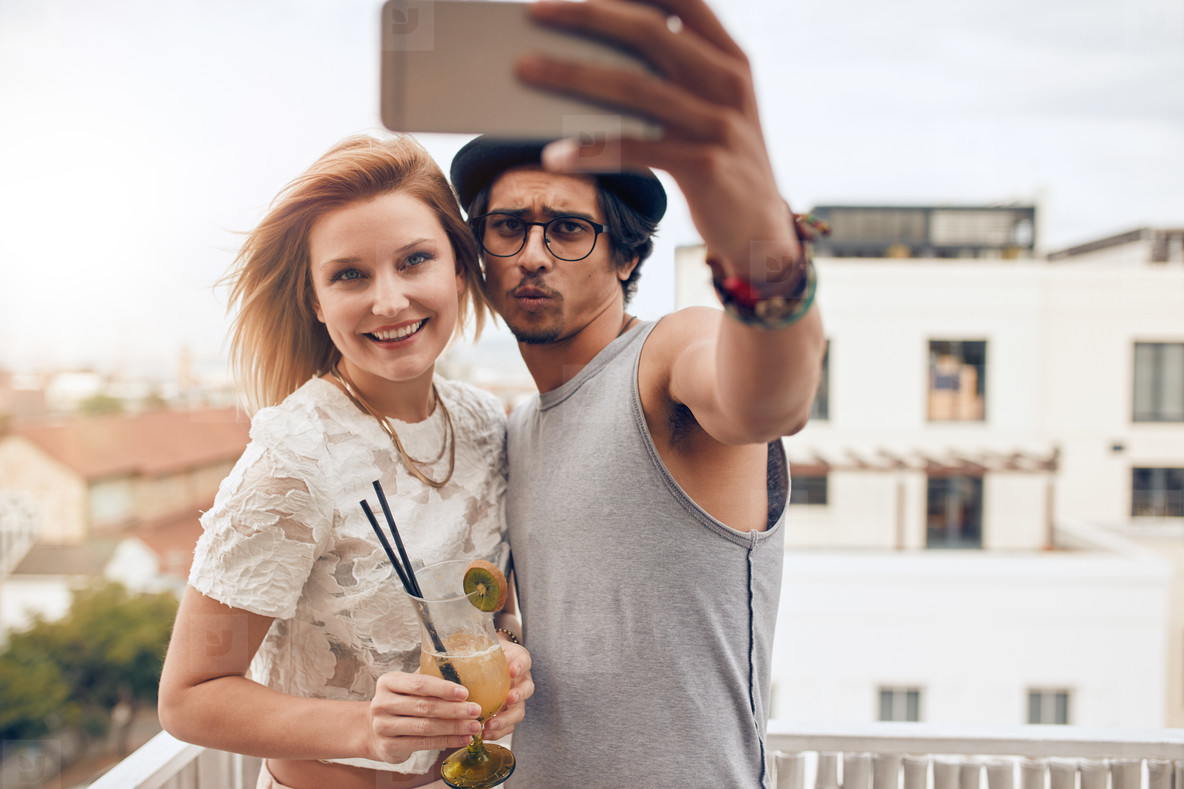 Young couple taking a selfie on the roof