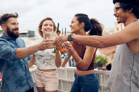 Friends enjoying cocktails at a rooftop party