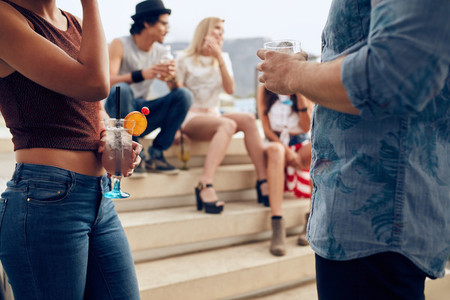 Young people having rooftop cocktail party